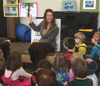 State Superintendent Kirsten Baesler reading to students