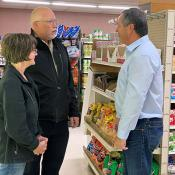 Commissioner Goehring visits with representatives from Tracy's Market in Fessenden, ND